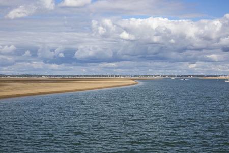 estuary: maritime seaside landscape with water, sand bank and white cloud, garonne estuary near Royan, France Stock Photo