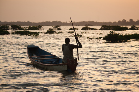silhouette of a fisherman in the sunset, Senegal, Saloum delta