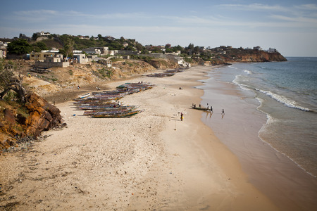 view on a beach with traditional Senegalese wooden boats, Senegal