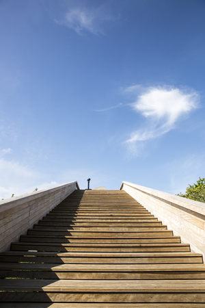 wooden staircase leading to a cloud