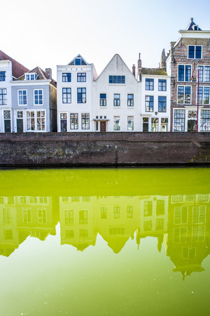 Dutch cityscape with gable houses along a canal Stock Photo