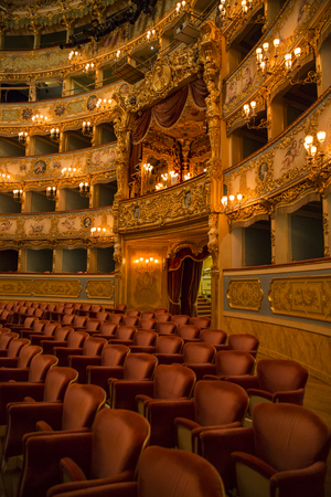 VENICE, ITALY – December 26, 2015: interior of historical theatre La Fenice. Rebuilt after it was destroyed by the fire in 1996, the famous opera house reopened in 2003 Editorial