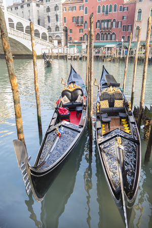 icone: VENICE, ITALY – December 25, 2015: gondolas on the Grand Canal, Gondola trip is the most popular touristic activity in Venice.
