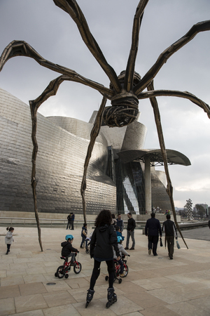 BILBAO, SPAIN - MARCH 19, 2013: Maman - spider sculpture by the artist Louise Bourgeois in front of The Guggenheim Museum in Bilbao, Biscay, Basque Country, Spain