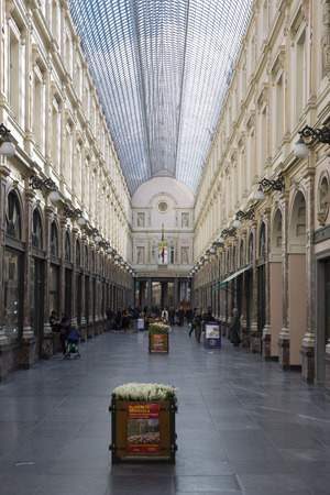 glasswork: Brussels, Belgium - April, 17 2016: Locals and tourists walking and shopping in historical Galeries Royales Saint-Hubert shopping arcades in Brussels , Belgium