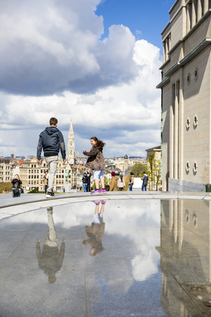 Brussels, Belgium - April, 17 2016:  View from Mont des Arts with on the tower of cityhall and children playing around a fountain. Editorial