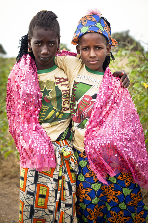 SENEGAL, Ferlo reserve, November, 2 2013: young girls in traditional outfit on the way to school.