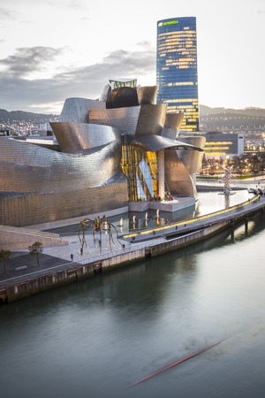 bilbo: Bilbao, Spain - January 29, 2016: evening view of modern and contemporary art Guggenheim Museum, designed by American architect Frank Gehry and inaugurated in October 1997.