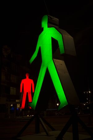 Amsterdam, the Netherlands December 20, 2015 : art piece called Strangers in the light from Victor Engbers & Ina Smits exhibited at Amsterdam Light Festival 2015 which is dedicated to theme Friendship from 28 November 2015 to 17 January 2016 Stock Photo