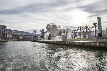 bilbo: Bilbao, Spain - January 30, 2016: black and white view of modern and contemporary art Guggenheim Museum, designed by American architect Frank Gehry and inaugurated in October 1997.