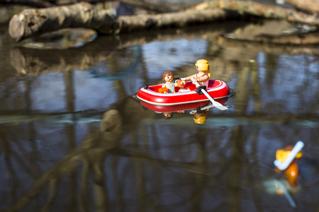 Amsterdam, the Nertherlands. April 12, 2015. A woman and child on a boat having fun in the water. Playmobil toy line exist since 1975 and is produced by the German company Brandtaetter.