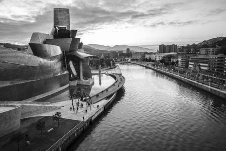 Bilbao, Spain - January 29, 2016: black and white night view of modern and contemporary art Guggenheim Museum, designed by American architect Frank Gehry and inaugurated in October 1997. Editorial