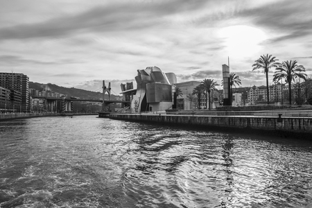 Bilbao, Spain - January 30, 2016: black and white view of modern and contemporary art Guggenheim Museum, designed by American architect Frank Gehry and inaugurated in October 1997.