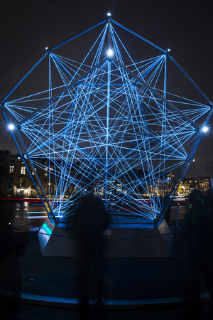Amsterdam, the Netherlands December 20, 2015 : artwork called The Uniting Lightstar  from Venividimultiplex exhibited at Amsterdam Light Festival 2015 which is dedicated to theme Friendship from 28112015 to 1701 Editorial
