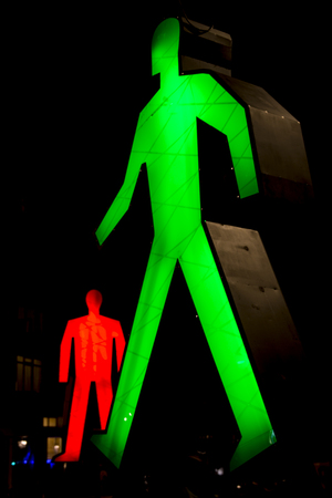 17 20: Amsterdam, the Netherlands December 20, 2015 : art piece called Strangers in the light from Victor Engbers & Ina Smits exhibited at Amsterdam Light Festival 2015 which is dedicated to theme Friendship from 28 November 2015 to 17 January 2016 Stock Photo