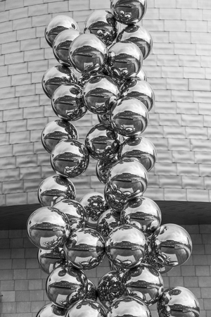 anish: BILBAO, SPAIN - MARCH 19, 2014: Sculpture The Big Tree consisting of 80 stainless steel balls with reflections by Anish Kapoor in front of The Guggenheim Museum in Bilbao, Basque Country, Spain Editorial