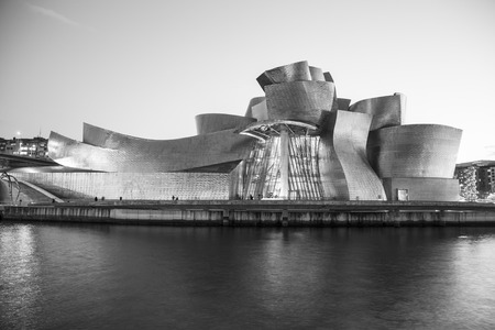 Bilbao, Spain - January 29, 2016: black and white evening view of modern and contemporary art Guggenheim Museum, designed by American architect Frank Gehry and inaugurated in October 1997.