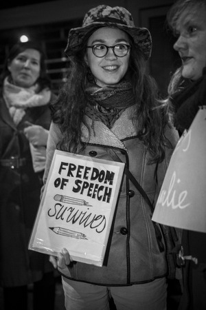Amsterdam, The Netherlands, January 08 2015: demonstation in solidarity with the attack against Charlie Hebdo in Paris, France on 07 January. Solidatirity in all languages, here a woman holding a sign saying I am Charlie