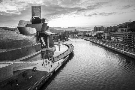 bilbo: Bilbao, Spain - January 29, 2016: black and white evening view of modern and contemporary art Guggenheim Museum, designed by American architect Frank Gehry and inaugurated in October 1997.