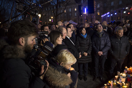 bombing: PARIS, FRANCE- January 10, 2016: Place de la Repbublique, ceremony to commemorate victims of the bombing and shooting rampage, Charlie Hebdo terrorist attack and Marches Republicaines demonstration