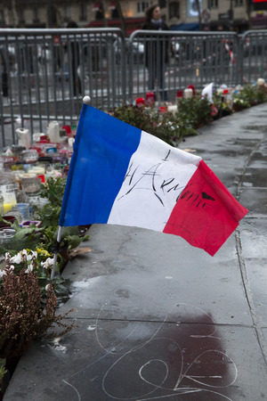 terrifying: PARIS, FRANCE � January 10, 2016: ceremony to commemorate victims of the bombing and shooting rampage, commemoration of Charlie Hebdo terrorist attack and of Marches Republicaines demonstration