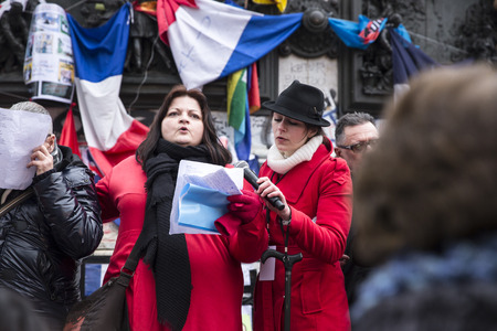 terrifying: PARIS, FRANCE - January 10, 2016: ceremony to commemorate victims of the bombing and shooting rampage, commemoration of Charlie Hebdo terrorist attack and of Marches Republicaines demonstration