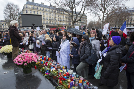 bombing: PARIS, FRANCE - January 10, 2016: ceremony to commemorate victims of the bombing and shooting rampage, commemoration of Charlie Hebdo terrorist attack and of Marches Republicaines demonstration