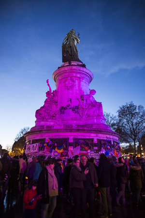 PARIS, FRANCE- January 10, 2016: Place de la Repbublique, ceremony to commemorate victims of the bombing and shooting rampage, Charlie Hebdo terrorist attack and Marches Republicaines demonstration