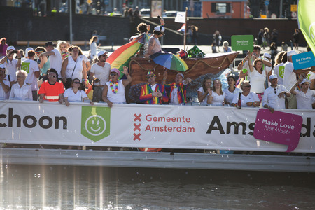 bisexual women: Amsterdam, the Netherlands - August 06, 2016: participants in the annual event for the protection of human rights and civil equality - Gay Pride Parade on the canals during Euro Pride 2016