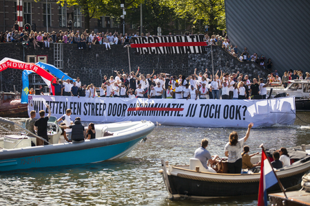 Amsterdam, the Netherlands – August 06, 2016: participants in the annual event for the protection of human rights and civil equality - Gay Pride Parade on the canals during Euro Pride 2016