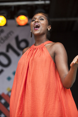 Amsterdam, the Netherlands – July 23, 2016: ZO gospel choir performing at the open air theater in Vondelpark for the Euro Pride Pink Saturday celebrations Editorial