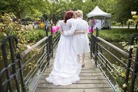 Amsterdam, the Netherlands – July 23, 2016: Fake burlesque weddings held during Pink Saturday Gay Euro Pride celebrations in Vondelpark