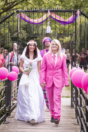 Amsterdam, the Netherlands – July 23, 2016: Fake burlesque weddings held during Pink Saturday Gay Euro Pride celebrations in Vondelpark Editorial