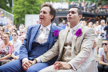 wedding feast: Amsterdam, the Netherlands – July 23, 2016: wedding ceremony of Lucien Spee, director from Amsterdam Gay Pride  association, and Victor at Vondelpark during Pink Saturday Gay Euro Pride celebrations Editorial