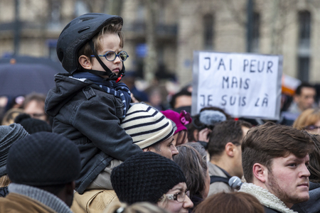terrifying: PARIS, FRANCE – January 10, 2016: ceremony to commemorate victims of the bombing and shooting rampage, commemoration of Charlie Hebdo terrorist attack and of Marches Republicaines demonstration