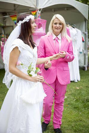wedding feast: Amsterdam, the Netherlands – July 23, 2016: Fake burlesque weddings held during Pink Saturday Gay Euro Pride celebrations in Vondelpark Editorial