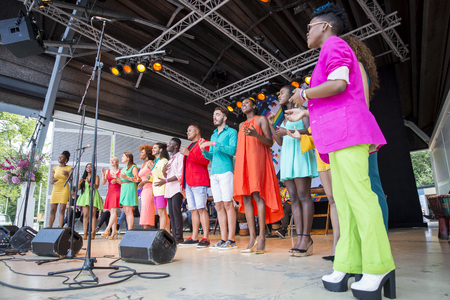 bisexual women: Amsterdam, the Netherlands – July 23, 2016: ZO gospel choir performing at the open air theater in Vondelpark for the Euro Pride Pink Saturday celebrations Editorial