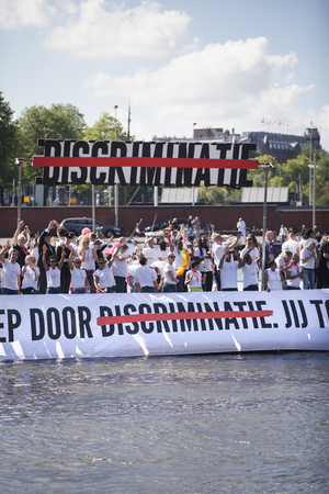 bisexual women: Amsterdam, the Netherlands – August 06, 2016: participants in the annual event for the protection of human rights and civil equality - Gay Pride Parade on the canals during Euro Pride 2016