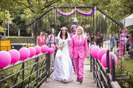 Amsterdam, the Netherlands – July 23, 2016: Fake burlesque weddings held during Pink Saturday Gay Euro Pride celebrations in Vondelpark