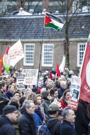 public demonstration: Amsterdam, The Netherlands - February 6,2016: public multi-cultural demonstration organized to protest against racism and islamophobia named Refugees welcome, racism not!