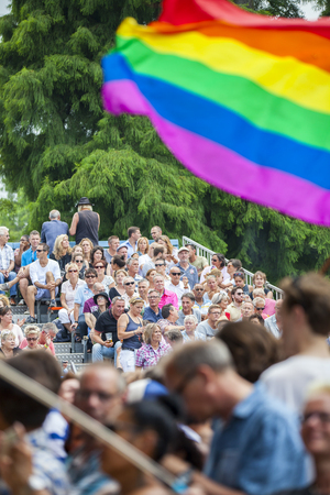 Amsterdam, the Netherlands - July 23, 2016: audience at concert of Anita Meyer singing in the Vondelpark Open Air Theatre during Pink Saturday celebration in Vondelpark for 2016 Gay Euro Pride