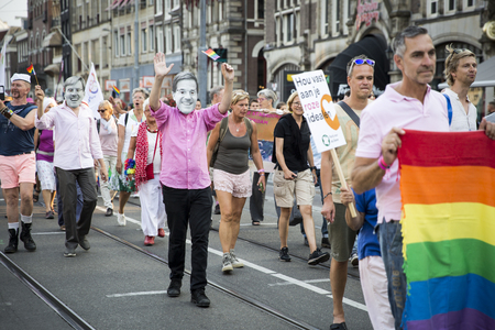 identidad cultural: Amsterdam, the Netherlands - July 23, 2016: people with king Willem-Alexander and prime minister Mark Rutte at Pride Walk, demonstration parade held during Pink Saturday Gay Euro Pride celebrations Editorial
