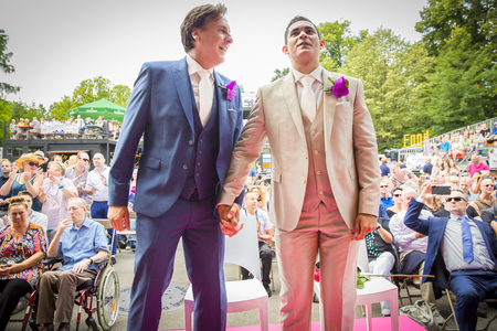 Amsterdam, the Netherlands - July 23, 2016: wedding ceremony of Lucien Spee, director from Amsterdam Gay Pride  association, and Victor at Vondelpark during Pink Saturday Gay Euro Pride celebrations