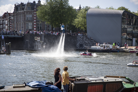 Amsterdam, the Netherlands - August 06, 2016: man making figures with a fly board during the annual event for the protection of human rights and civil equality - Gay Pride Parade, Euro Pride 2016