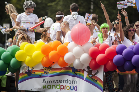 Amsterdam, Netherlands - August 1, 2015: participants in the annual event for the protection of human rights and civil equality - Gay Pride Parade on the Prinsengracht, Amsterdam