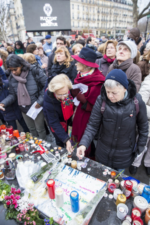 fraternity: PARIS, FRANCE - January 10, 2016: ceremony to commemorate victims of the bombing and shooting rampage, commemoration of Charlie Hebdo terrorist attack and of Marches Republicaines demonstration