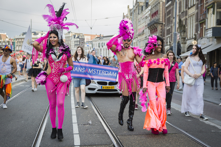 Amsterdam, the Netherlands - July 23, 2016: drag queens dressed in pink at Pride Walk, demonstration parade from Vondelpark to Dam Square during Pink Saturday Gay Euro Pride celebrations Editorial