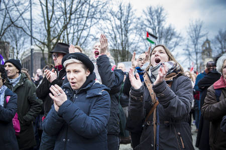 public demonstration: Amsterdam, The Netherlands - February 6, 2016: public multi-cultural demonstration organized to protest against racism and islamophobia named Refugees welcome, racism not!