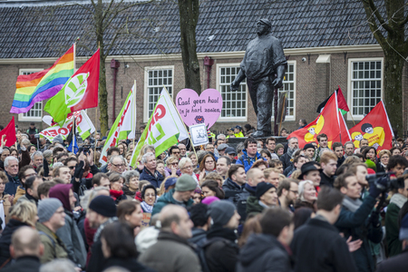 Amsterdam, The Netherlands - February 6, 2016: public multi-cultural demonstration organized to protest against racism and islamophobia named Refugees welcome, racism not!