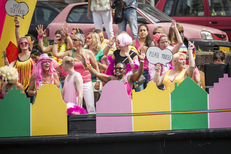 canal parade: Amsterdam, Netherlands - August 1, 2015: participants in the annual event for the protection of human rights and civil equality - Gay Pride Parade on the Prinsengracht, Amsterdam